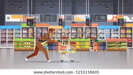 running business man customer with shopping trolley cart busy male shopper buying products grocery market interior flat horizontal