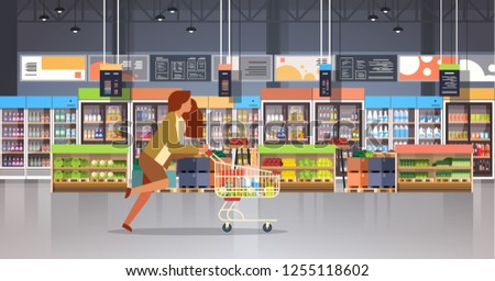 running business woman customer with shopping trolley cart busy female shopper buying products grocery market interior flat horizontal