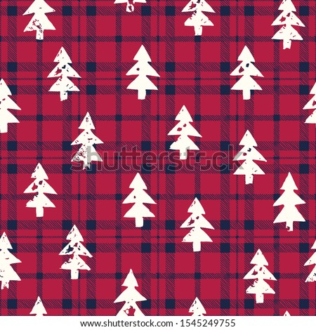 Rustic Woodland Vector Seamless Pattern with White Hand-Stamped Textured Silhouettes of Christmas Trees on Classic Blue and Red Checkered Plaid Background.Farmhouse Style Autumn, Winter Holidays Print