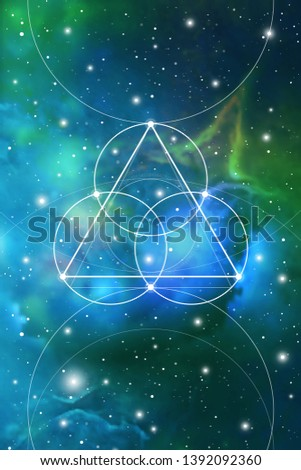 Sacred geometry  flower of life design template with golden ratio numbers, interlocking circles, triangles and squares, flows of energy and particles in front of outer space background.