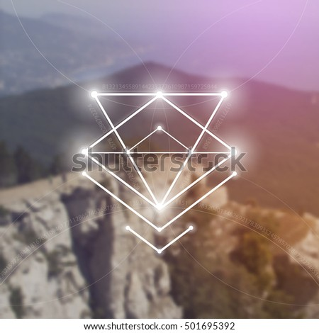 Sacred geometry symbol on blurred photo background. Mathematics and spirituality in nature. The formula of nature. Interlocking glowing geometry shapes.