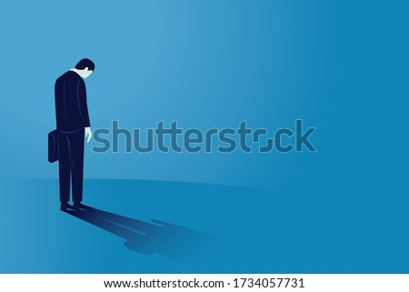 Sad businessman looking down, rear view. Man feeling lonely and having mental pressure or stress. Bankruptcy on global economic recession, failure concept