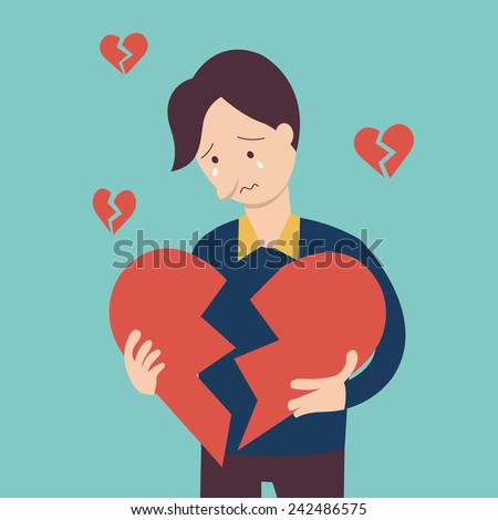 sad man holding broken heart