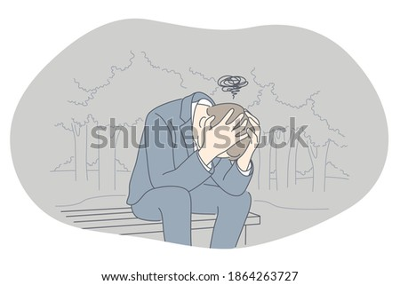 Sadness, mental depression, bad news concept. Young unhappy man sitting on bench with head in hands feeling depressed with thoughts after negative events, crying, suffering from loneliness  Foto stock ©