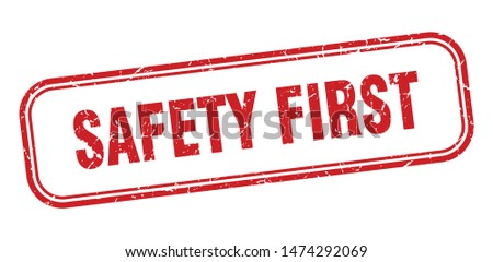 safety first stamp. safety first square grunge sign. safety first