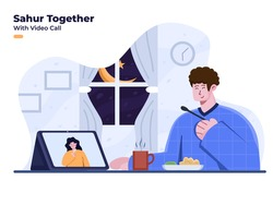 Sahur or Iftar together with video call. Pre-dawn meal or suhoor together during Ramadan month and Covid-19 pandemic. Iftar party with video call and stay at home. Celebrate Ramadan kareem together.