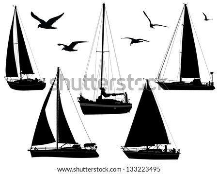 sail boats in silhouettes with