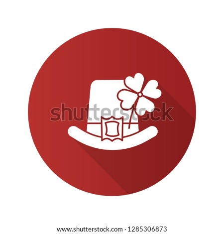 Saint Patrick's Day flat design long shadow glyph icon. March 17th. Leprechaun hat with four leaf clover. Vector silhouette illustration
