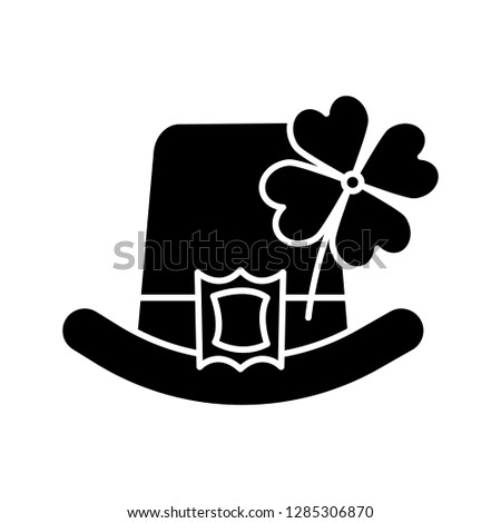 Saint Patrick's Day glyph icon. March 17th. Leprechaun hat with four leaf clover. Silhouette symbol. Negative space. Vector isolated illustration