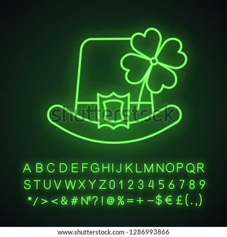 Saint Patrick's Day neon light icon. March 17th. Leprechaun hat with four leaf clover. Glowing sign with alphabet, numbers and symbols. Vector isolated illustration