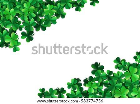 Saint Patricks day background with sprayed clover leaves or shamrocks.