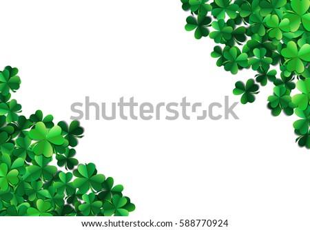 Saint Patricks day background with sprayed clover leaves or shamrocks