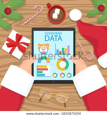 santa claus is holding tablet