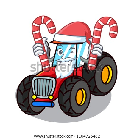 santa with candy tractor mascot