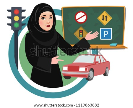 Saudi Arab Women are now allowed to drive in Saudi Arabia. Woman teaching traffic rules and signals in female driving license course. Guidance and training in Driving School.
