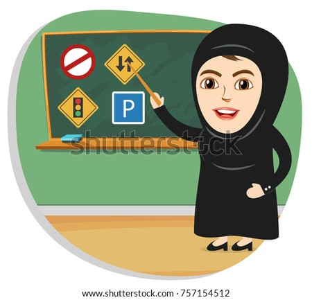 Saudi Arab Women are now allowed to drive in Saudi Arabia. Woman teaching traffic rules and signals in female driving license course.