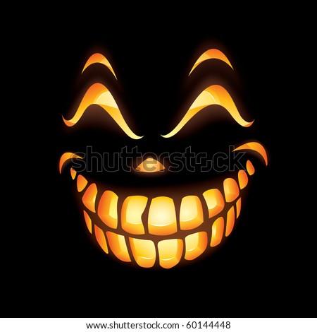 Scary Jack O Lantern smiling in the dark