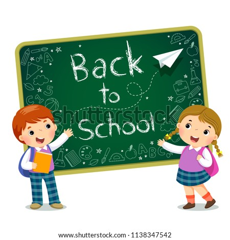 School kids with text of Back to School on the blackboard