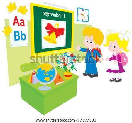 Schoolboy and schoolgirl in a classroom of grade school