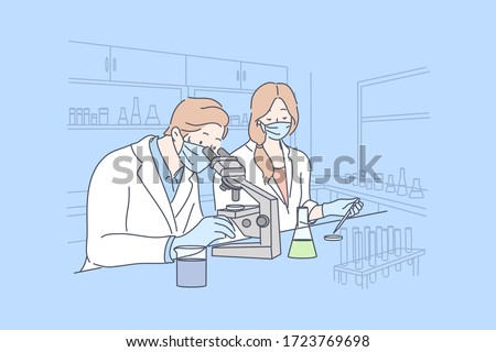 Science, coronavirus, chemistry, medical vaccine concept. Team of man and woman doctors workers in medical face mask creates vaccine from COVID19. Scientific test academic research 2019ncov infection.