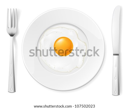 Scrambled egg in a bowl with a fork and knife