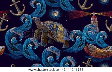 sea turtle swims in night ocean