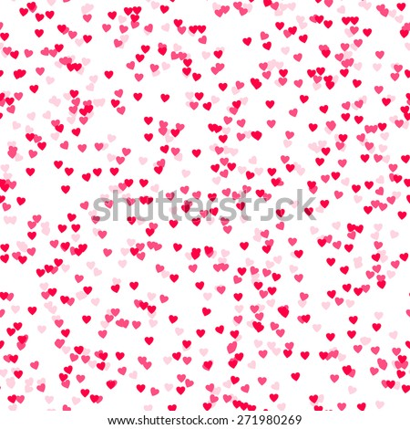 Seamless background with many tiny heart shaped confetti pieces
