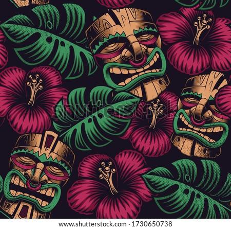 Seamless color pattern with a tiki mask on Polynesia style on dark background Stockfoto ©