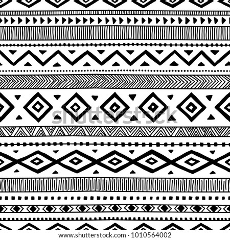 Seamless ethnic pattern. Handmade. Horizontal stripes. Black and white print for your textiles. Vector illustration.
