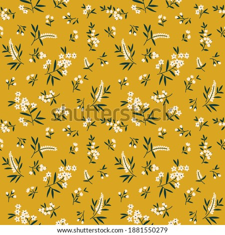 Seamless floral pattern. Ditsy background of small white flowers and dark green leaves. Small-scale flowers scattered over a yellow background. Stock vector for printing on surfaces and web design.