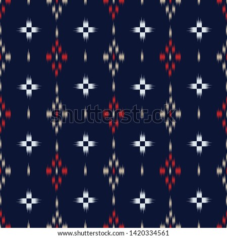seamless ikat and tribal pattern on navy