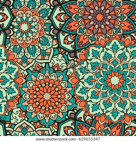 Seamless mandala pattern for printing on fabric or paper. Hand drawn background. Colorful, bright print.