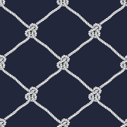 Seamless nautical rope pattern. Endless navy illustration with white fishing net ornament and marine knots on dark blue backdrop. Trendy maritime style background. For fabric, wallpaper, wrapping