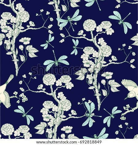 Seamless pattern in the chinoiserie style with peonies, dragonfly and bird on deep blue background for wedding, scrapbooking, wallpaper and other design.