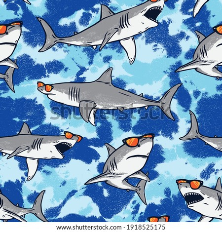 Seamless pattern of a sharks and tie dye with blue background elements