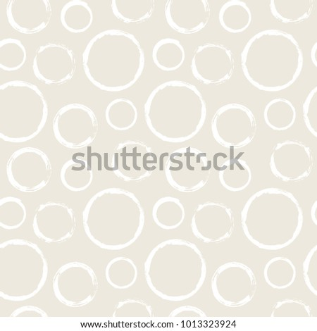 Seamless pattern with grunge circles. Hand drawn round shapes background. Beige white brush stroke texture. Geometric graphic design element. Scrapbook wallpaper. Vector illustration