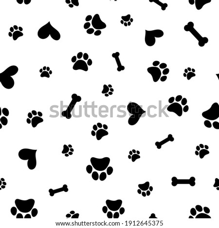 Seamless pattern with hearts and paw prints of animals. Vector footprint tile background repeat wallpaper illustration. Creative texture for fabric, wrapping,  textile, wallpaper, apparel. Surface pat ストックフォト ©