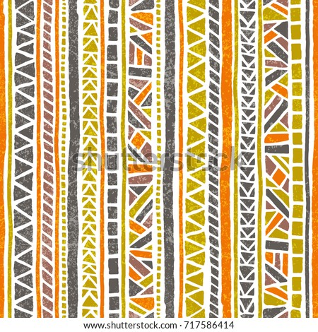 Seamless striped pattern. Ethnic and tribal motifs. Vintage print, grunge texture.Simple ornament. Handmade. Orange, green, gray and white colors. Vector illustration. - Shutterstock ID 717586414