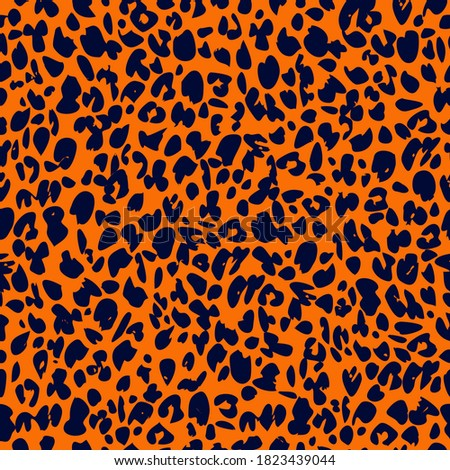 Seamless vector pattern of Leopard prints on amberglow color background for t-shirt print design.  Foto stock ©