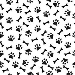 Seamless vector pattern with hand drawn bones and paws