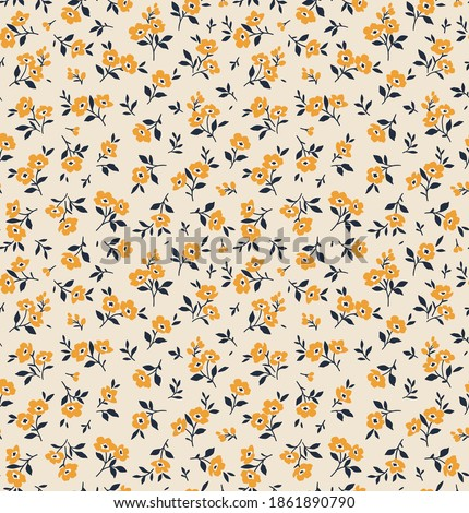 Seamless vintage floral pattern. Beautiful yellow flowers and dark blue leaves on beige background. Delicate flowers in ditsy style. Stock vector for prints on surface. Foto stock ©