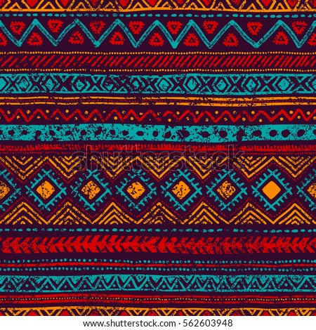 Seamless vintage pattern. Grungy texture. Ethnic and tribal motifs. Blue, orange, red and purple colors. Vector illustration. - Shutterstock ID 562603948