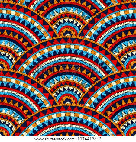 Seamless wavy embroidered pattern. Handmade. Blue, red, white and orange colors. Prints for textiles. Ethnic and tribal motifs. Complex patchwork ornament. Vector illustration.