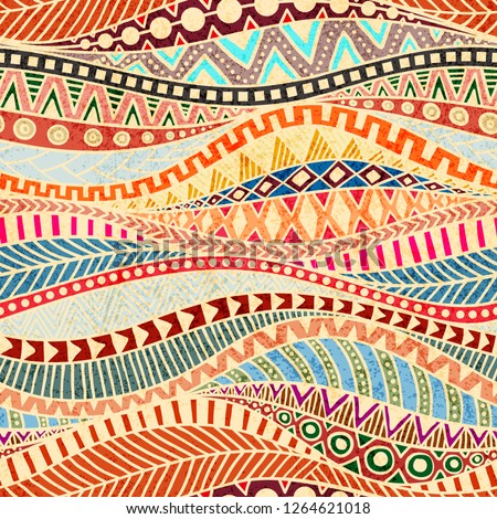 Seamless wavy pattern. Ethnic and tribal motifs. Colorful african print for textiles. Grunge texture. Ornate ornament drawn by hand.