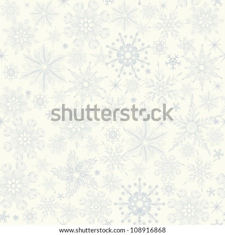 seamless winter pattern with blue snowflakes on white background