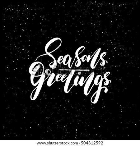 Seasons greetings - brush script calligraphic design for Xmas greetings cards, invitations. Handwritten calligraphy on black subtle ink spotted texture background.