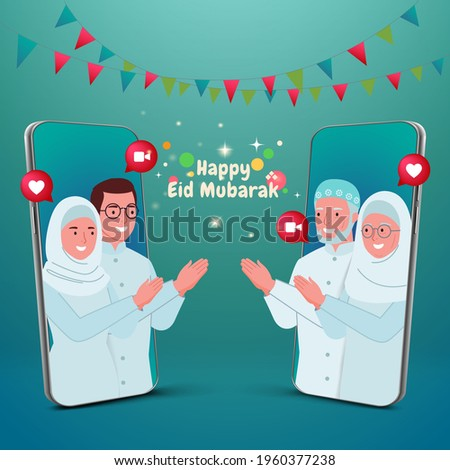 Selamat hari raya Idul Fitri or is another language of happy eid mubarak in Indonesian. muslim family blessing Eid mubarak with smart phone screens using video call during Covid-19