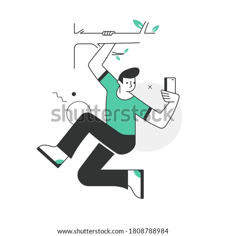 Selfie. A man with a smartphone in hand hanging on the tree branch making photo of himself. Concept of taking selfies in unusual situations. Scenes from the world of business and technology