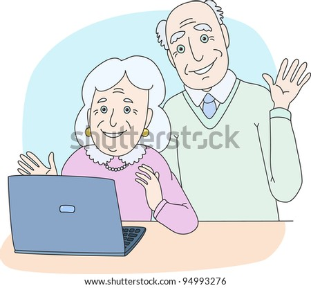 Senior couple using computer at home