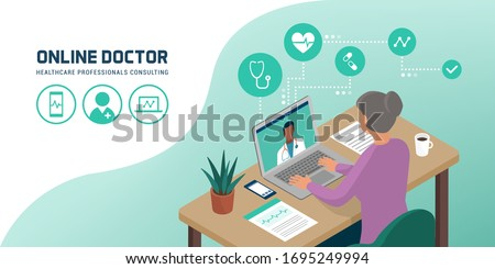 Senior woman connecting with her laptop and videocalling her doctor from home, telemedicine concept